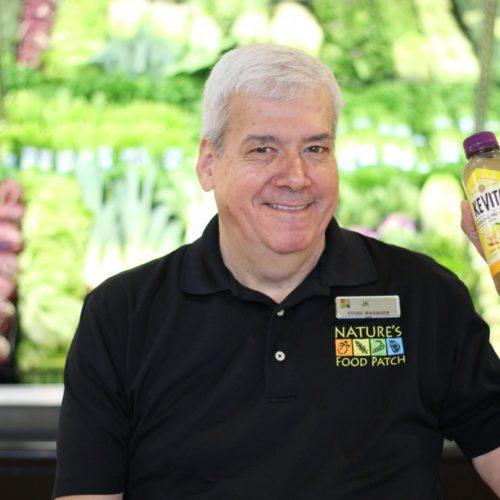 John Klein holding a kombucha beverage