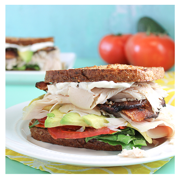 """The Patch Turkey Club Our favorite turkey club, Patch-style! Oven-roasted turkey breast, avocado, tomato & bacon piled high on organic romaine lettuce & Vegenaise pressed on sprouted bread. MAKE IT VEGAN - Sub Tofurky vegan """"turkey"""" slices & local, non-gmo tempeh """"bacon"""" for an add'l $3. Made Fresh from Scratch at The Patch with Organic Ingredients."""
